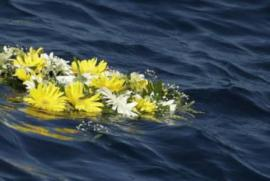 Flower wreath to commemorate migrants dead at sea