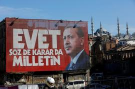 "A billboard with picture of Turkish President Tayyip Erdogan and a slogan for the ""Yes"" at the referendum"