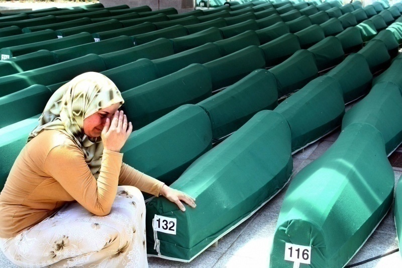 A Bosnian woman cries beside the coffins of Muslim men and boys before their burial in Potocari, near Srebrenica.