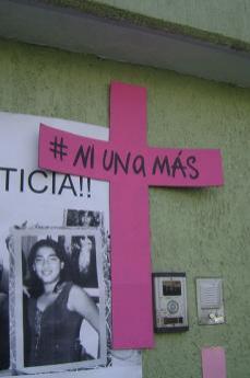 Susanna Chavez's slogan written on a cross afeter her death (Photo  by Flickr: user Diegoehg_)