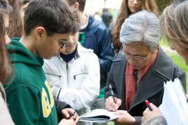 Claire Ly autographs her books at the Milan Garden of the Righteous