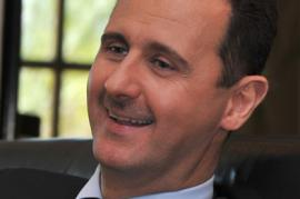 A grimming Bashar al-Assad (picture by the Syrian government press office)