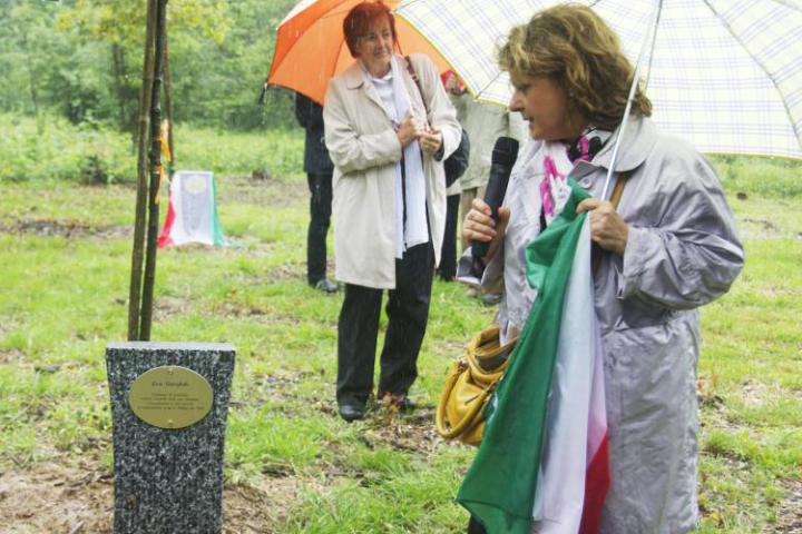 Lawyer Enza Rando admiring the stone dedicated to Lea Garofalo