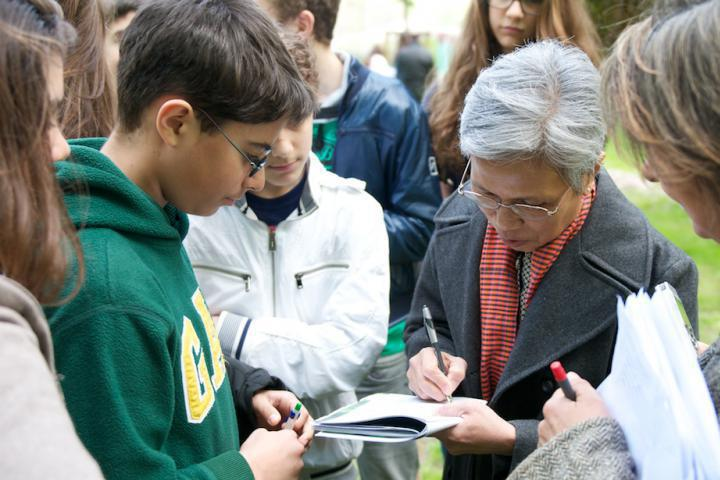 Claire Ly signs brochure for the students