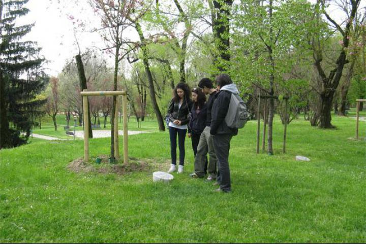Students looking at the memorial stone