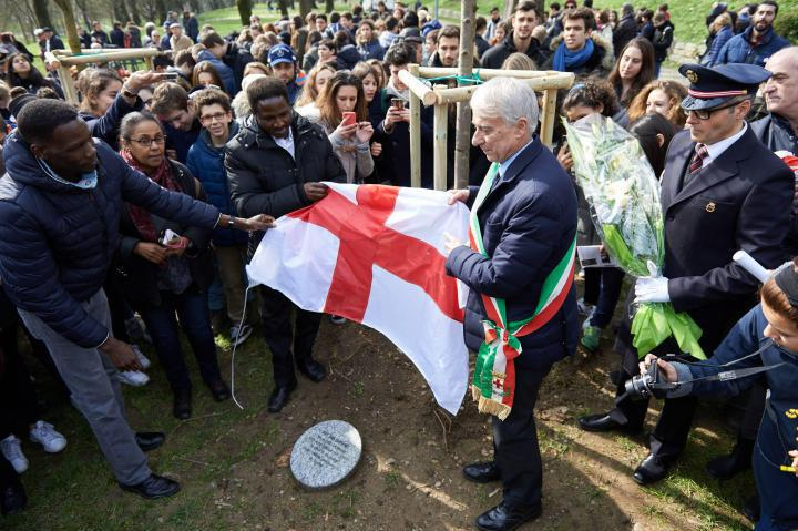 Unveiling the stone for Halima Bashir with members of the Sudanese community