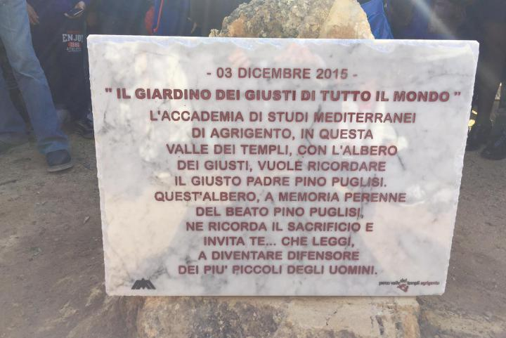 The plaque in honor of Don Pino Puglisi