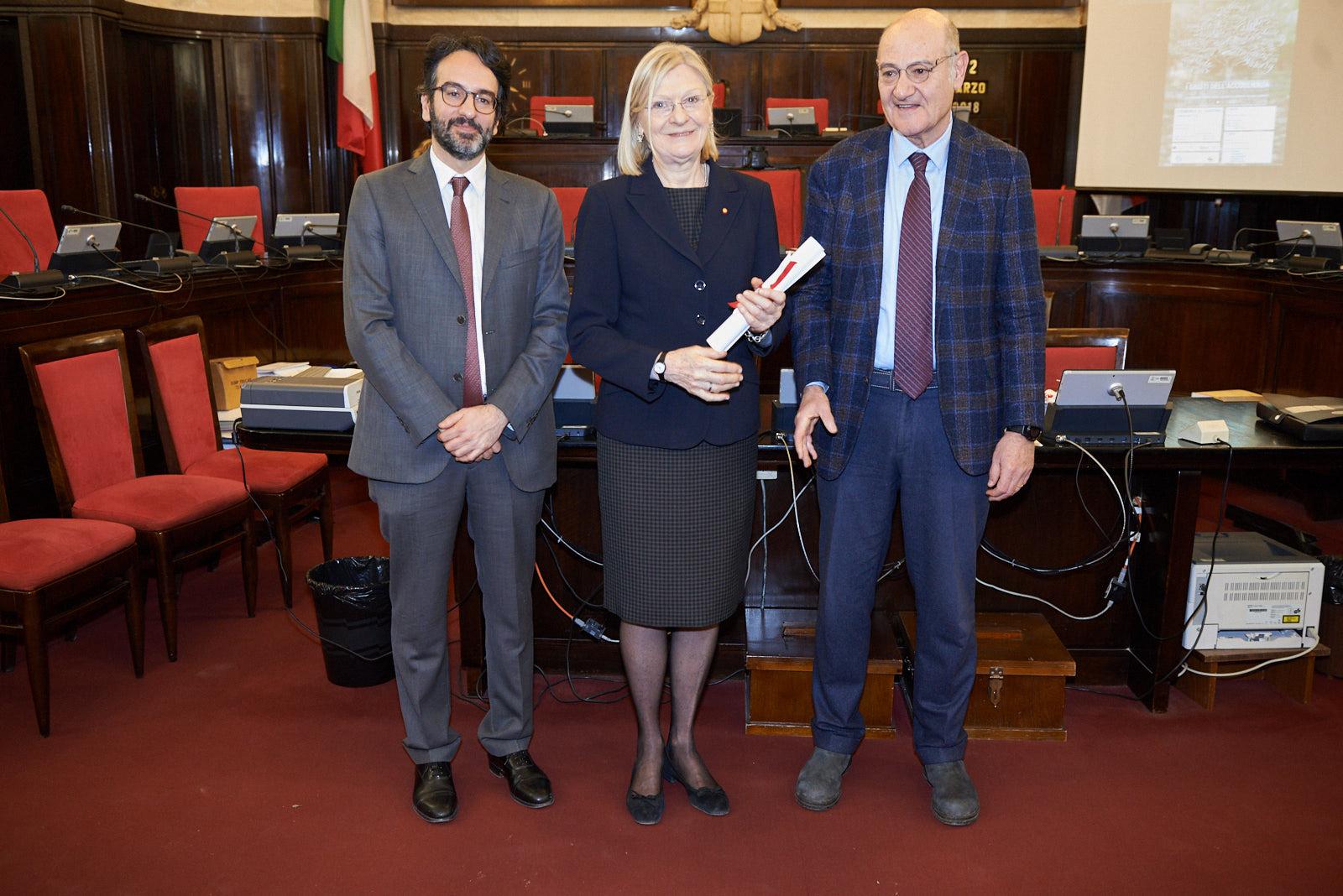 Silvia Rivetti picks up the parchment for her grandfather, Gen. Guglielmo Barbò