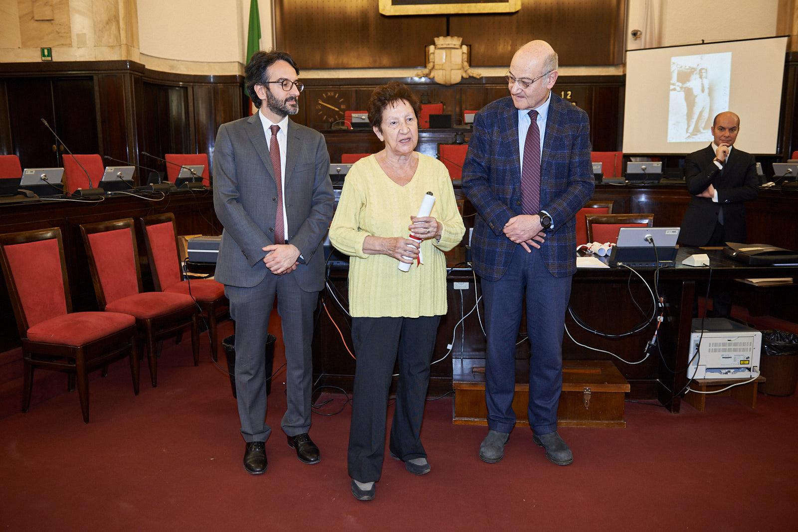 Marilena Dossena  picks up the parchment for Corrado Bonfantini
