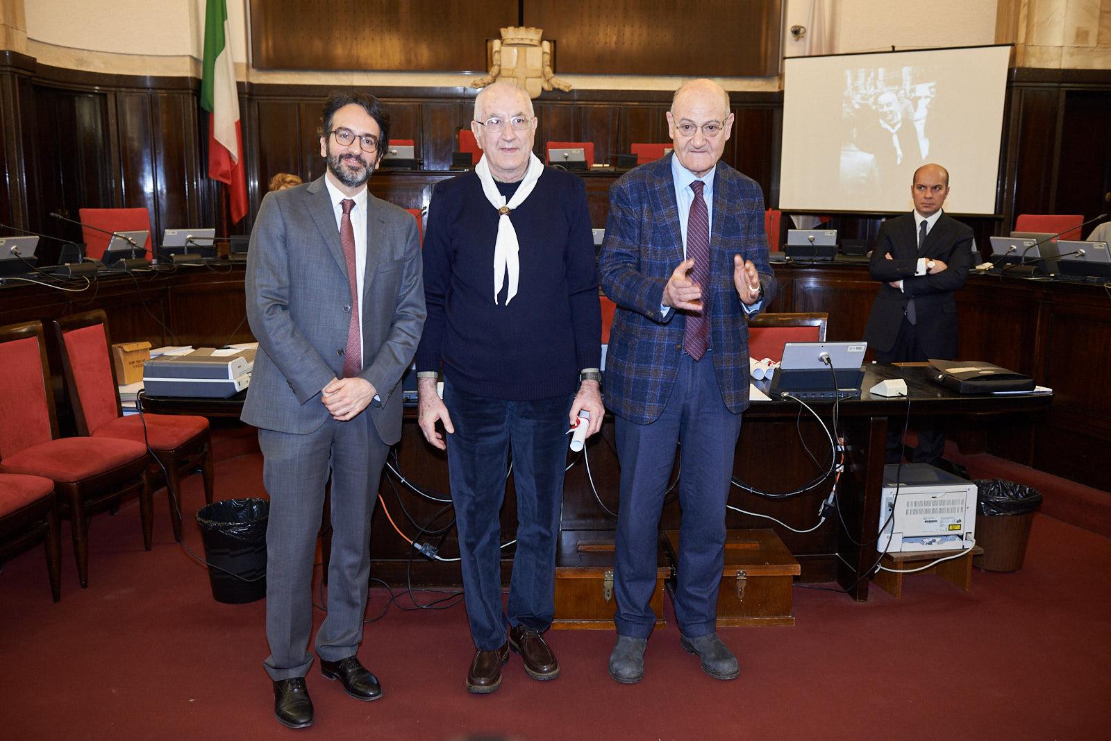 Vittorio Cagnoni picks up the parchment for Father Andrea Ghetti