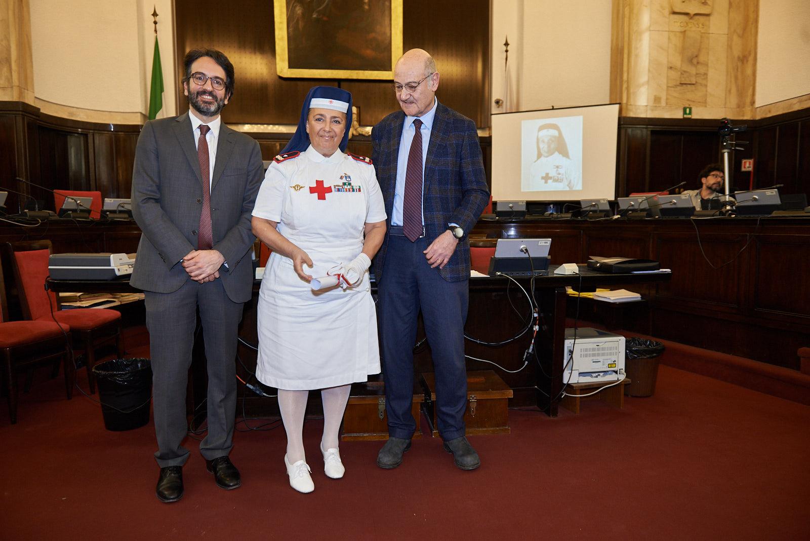 Sister Monica Dialuce Gambino picks up the parchment for Maria Vittoria Zeme