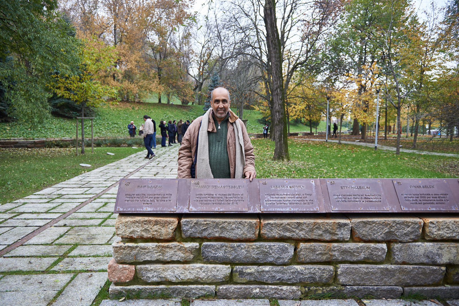Hamadi with the memorial stone dedicated to him