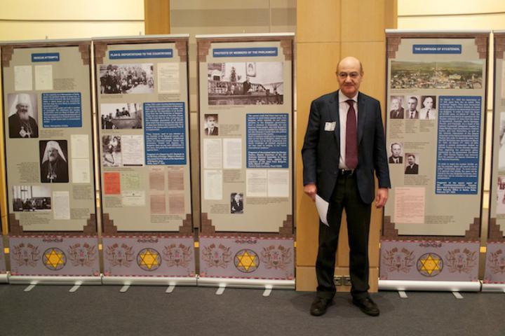 Nissim near the plasterboards of exhibition about the rescue of Bulgarian Jews
