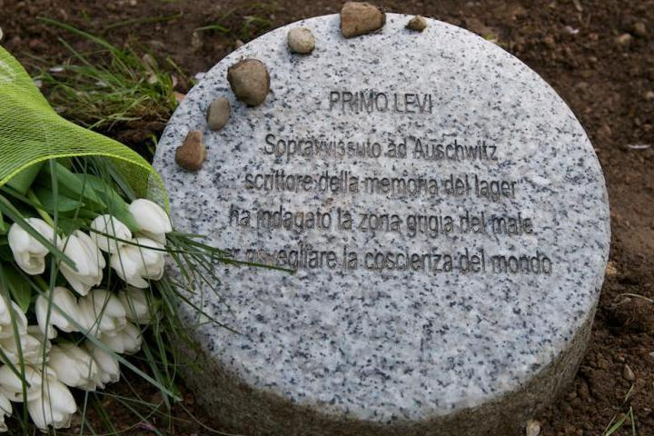 The memorial stone dedicated to Primo Levi with typical Jewish wreaths