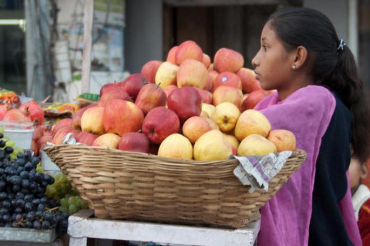 Indian woman with a basket of apples