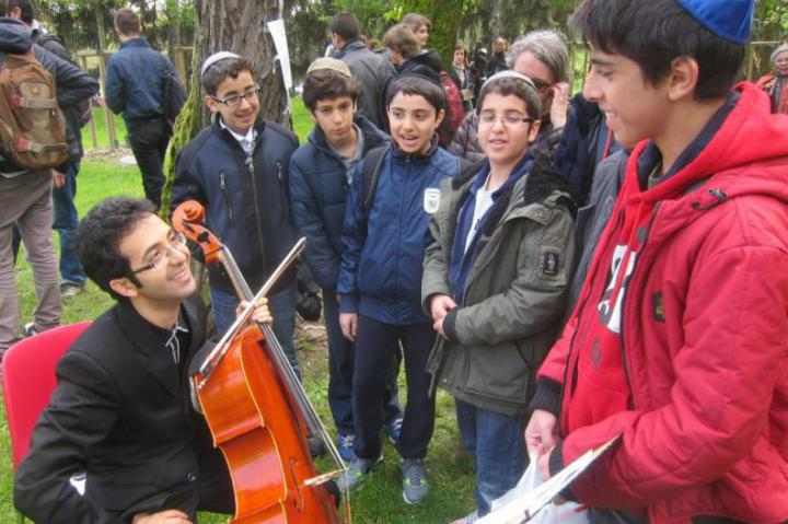 Iranian cellist Babak Khayami with some students