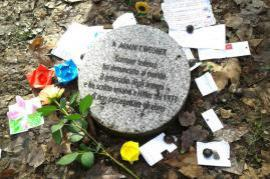 Children laid flowers and dedications near the stones dedicated to the Righteous